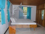 Bed, One Bedroom Chalet | Kokogrove Chalets | Mahe, Anse Royale, Seychelles